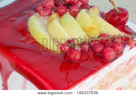 A piece cake on dish with currant in a relaxing time. Close up cake with red currant