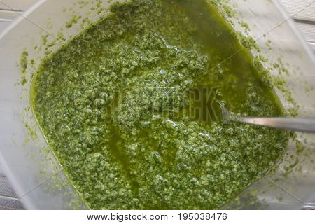 pesto sauce of basil made by hand at home