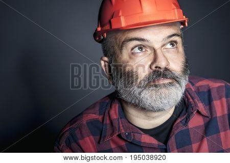 studio portrait of worker with protection helmet