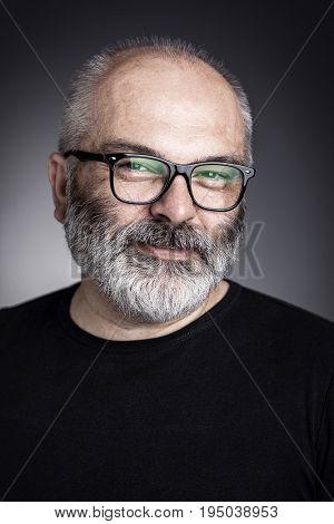 man with glasses studio portrait