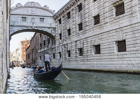 VENICE ITALY - JULY 01: view of Bridge of Sighs with gondolas on July 1 2017 in Venice Italy