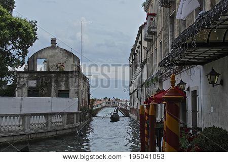 Venice Italy Gondola wide shot bridge blue sky
