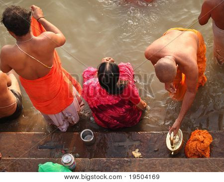 VARANASI, INDIA - NOVEMBER 6: Unidentified people wash themselves in the river Ganga on Nov. 6, 2010 in the holy city of Varanasi, India. The holy ritual of washing is held every day.