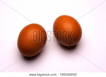 Two eggs isolated on white background. Food