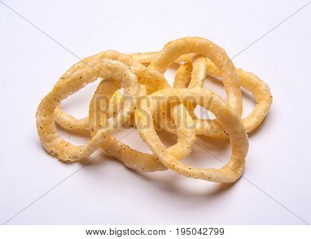 Chips like onion rings on white background. Food. Snake