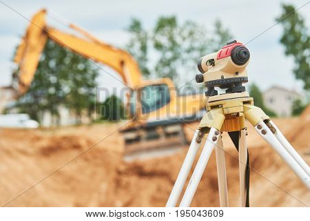 Surveyor equipment level outdoors at construction site