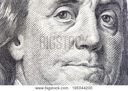 Portrait of Benjamin Franklin on one hundred dollar bill close-up.