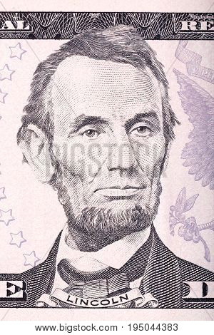 Abraham Lincoln portrait from five dollars bill close-up.