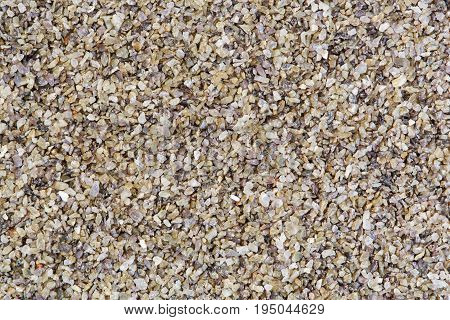 Horizontal gravel texture from quartz stones. High res macro photo.