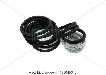 Pieces of hair elastics to tie hair. Rubber head dressing in Black Grey on white background