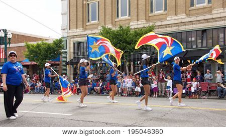 Alameda CA - July 04 2017: The Alameda 4th of July Parade is one of the largest and longest Independence Day parade in the nation. Lincoln Middle School Band flag girls performing for the crowd.