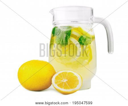 Refreshing and tasty summer beverage with refreshing, juicy and fresh lemons with bright green mint and crushed ice in a modern jug, isolated on white background. Classic lemonade in jug.