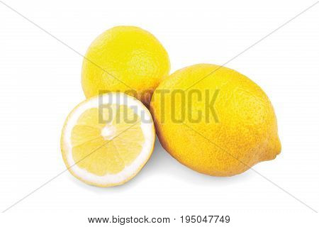 A group of ripe, yellow and bright lemons isolated on white background. Two whole bright yellow ripe lemon and one cut lemon. Fresh yellow lemons. Citrus fruit. Vitamins.