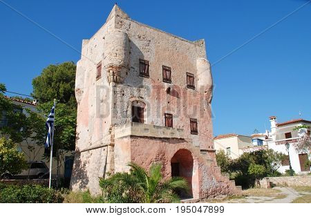 AEGINA, GREECE - APRIL 26, 2017: The historic Markellos Tower in Aegina Town on the Greek island of Aegina. The tower was once used as a seat of Greek government during the War of Independence.