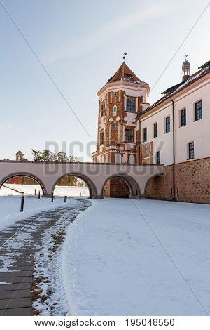 Mir Castle in Minsk region is ancient heritage of Belarus. UNESCO World Heritage. Winter scene with snow.