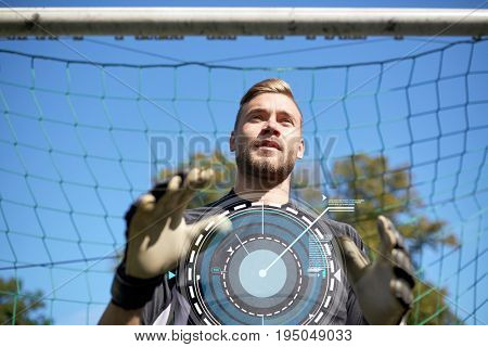 sport, technology and people - soccer player or goalkeeper at football goal on field