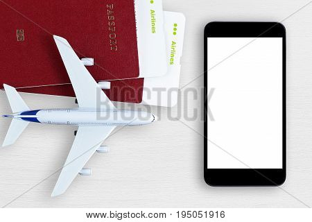 Air tickets passports smartphone and toy plane on table