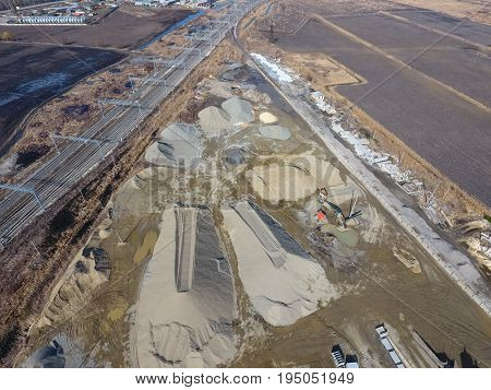 Heaps Of Rubble And Pebbles. For Road Repair Plant. The Site Wit