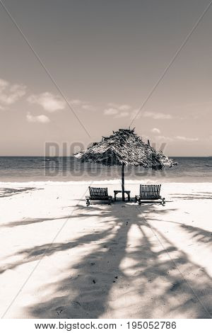 BORACAY WESTERN VISAYAS PHILIPPINES - JANUARY 14 2015: Black and white picture of a tent to protect people against the hard heat. nobody in this sunny day.