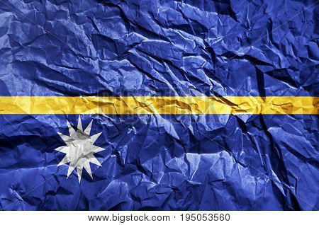 Nauru flag painted on crumpled paper background