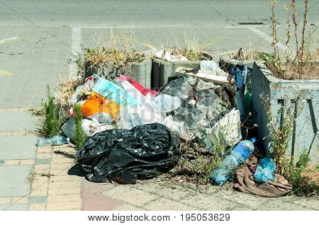Urban city pollution. Garbage on the street. Litter.