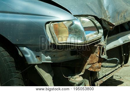 Broken headlight. Front end of the car damaged in car crash accident.
