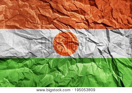 Niger flag painted on crumpled paper background