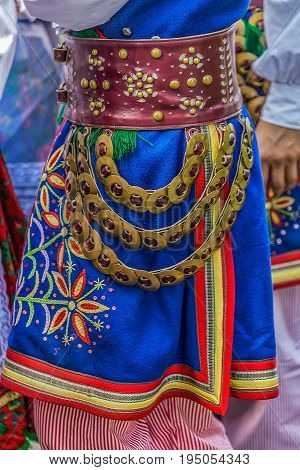 Detail of Polish folk costume for man with multicolored embroidery.