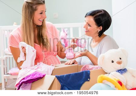 Soon-to-be mums choosing babywear for neonates