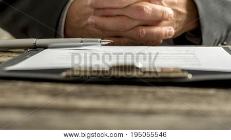 Businessman In A Meeting With Clasped Hands