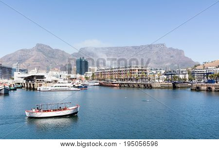 Cape Town South Africa - March 02 2017: Ferry boat in Cape Town Harbour with Table Mountain in background