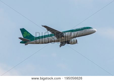 London UK - July 9 2017: Plane Airbus A320 Aer Lingus Airlines takes of from London Heathrow Airport