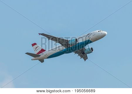 London UK - July 9 2017: Plane Airbus A320 Austrian Airlines takes off from London Heathrow Airport
