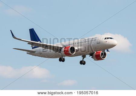 London UK - July 9 2017: Airbus A320 SAS Scandinavian Airlines landing at London Heathrow Airport