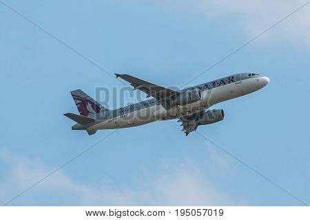 London UK - July 9 2017: Plane Airbus A320 Qatar Airways takes off from London Heathrow Airport