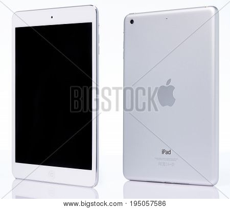 New york, USA - July 11, 2017: White ipad mini perspective view isolated on white background. Back and front view of ipad mini