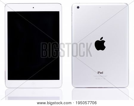 New york, USA - July 11, 2017: White ipad mini tablet isolated on white background. Back and front view of ipad mini