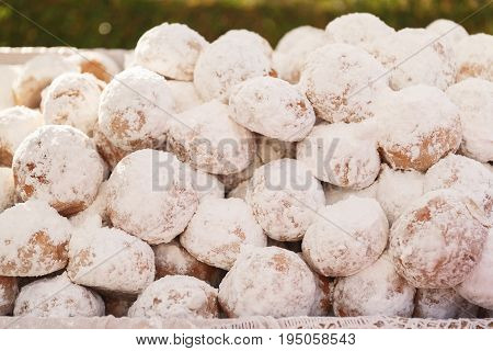 Homemade Kourabiedes covered with icing sugar, Greek  traditional Christmas butter cookies.A macro photograph with very shallow depth of field
