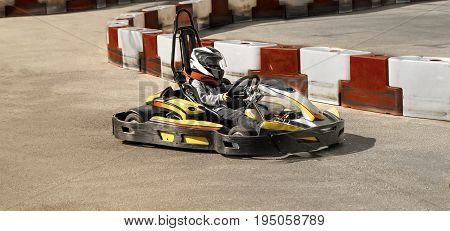Go kart, karting speed rival outdoor race opposition race, racing with fury,  a fury,fast and furious    image taken in a sunny warm day on a racing track