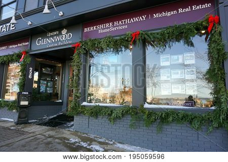PETOSKEY, MICHIGAN / UNITED STATES - NOVEMBER 22, 2016: One may buy or sell real estate through Berkshire Hathaway, on Mitchell Street in downtown Petoskey.