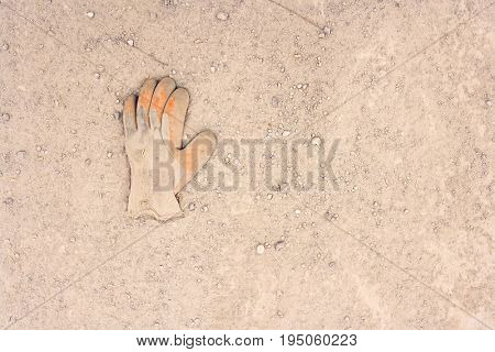 Closeup of work glove lying in the dirt