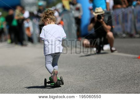 Small children racing in cycling sports competitions on Saturday day