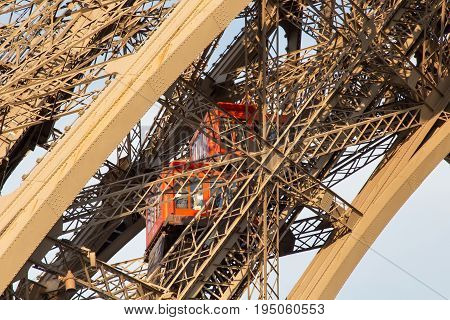 Elevator of the Eiffel Tower in Paris. France. The Eiffel Tower was constructed from 1887-1889 as the entrance to the 1889 World's Fair by engineer Gustave Eiffel.