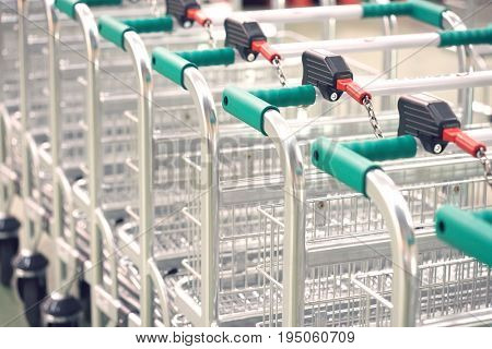Closeup of empty shopping carts linked together