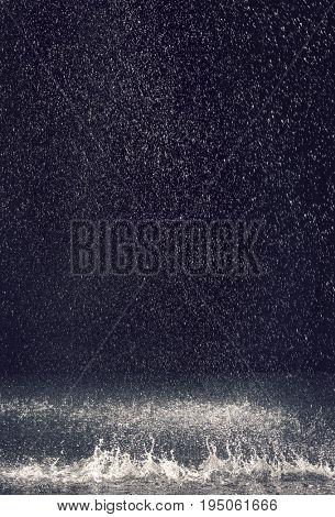Rain over black background
