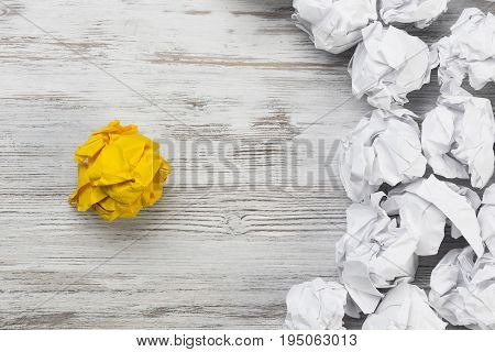 Set of crumpled paper balls with one colorful