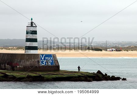 Old pier lighthouse in Fortaleza de Peniche (Fort of Peniche), Portugal