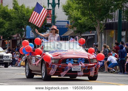 Alameda CA - July 04 2017: Ellen Corbett EBRPD Board Member in the Alameda 4th of July Parade one of the largest and longest Independence Day parade in the nation.