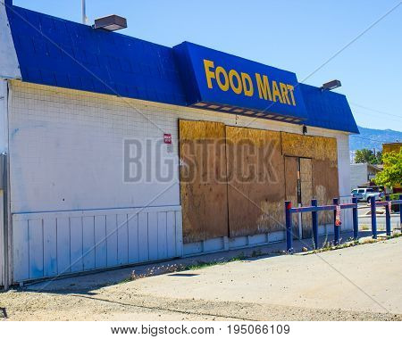 Abandoned Food Store With Boarded Up Windows