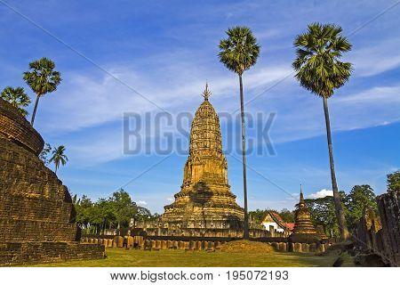 Old architecture Wat Phra Si Ratanamahathat temple and sugar palm in Sisatchanalai Historical Park Sukhothai province Thailand